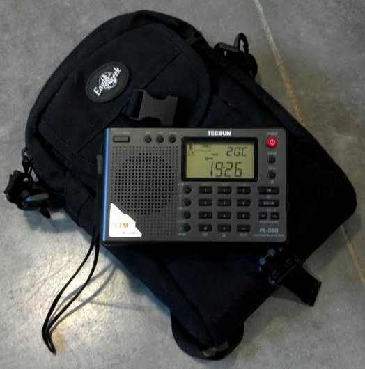 My Tecsun PL-380 and the small Eagle Creek pack that also holds my Zoom H1 recorder, earphones, audio cables, external antenna, spare batteries and Kindle.