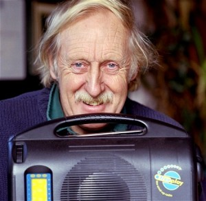 Trevor Baylis with an original BayGen clockwork radio (Photo source: The Telegraph)