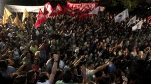 Thousands of protesters gathered outside ERT's headquarters in Athens (Source: BBC News)