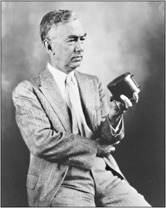 A portrait of Frank Conrad in 1921; holding a microphone in his hand (Source: Wikimedia Commons)