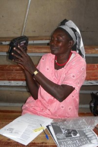 Teacher in rural South Sudan with an ETOW radio. (Project Education Sudan Journey of Hope 2010)