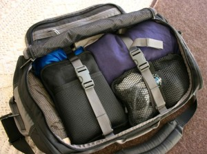 My Timbuk2 Small Wingman is very compact, yet holds everything I need--including radio gear--for two weeks (or more!) of travel.