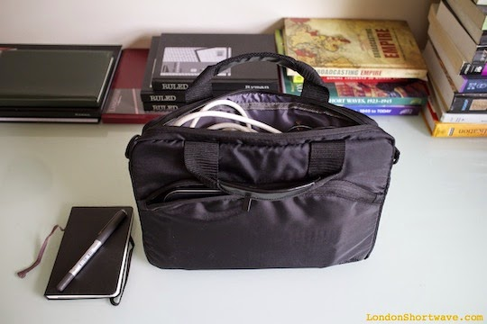 """Figure 3. Packing the components into an 11"""" carrier bag"""