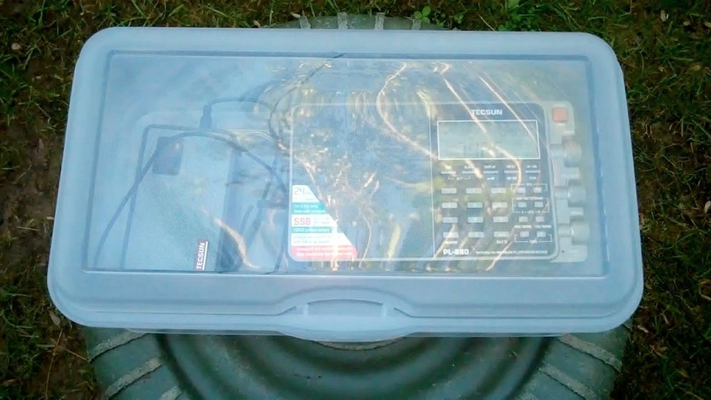 Richard's Tecsun PL-880 and digital recorder in a protective plastic case outdoors.