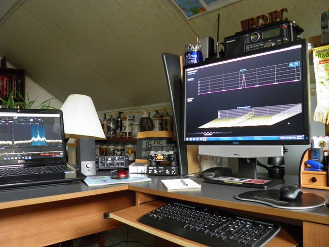 John's shack features the CommRadio CR-1a, RFspace SDR-IQ, Winradio G33DDC Excalibur Pro, and the Grundig Satellite 750.