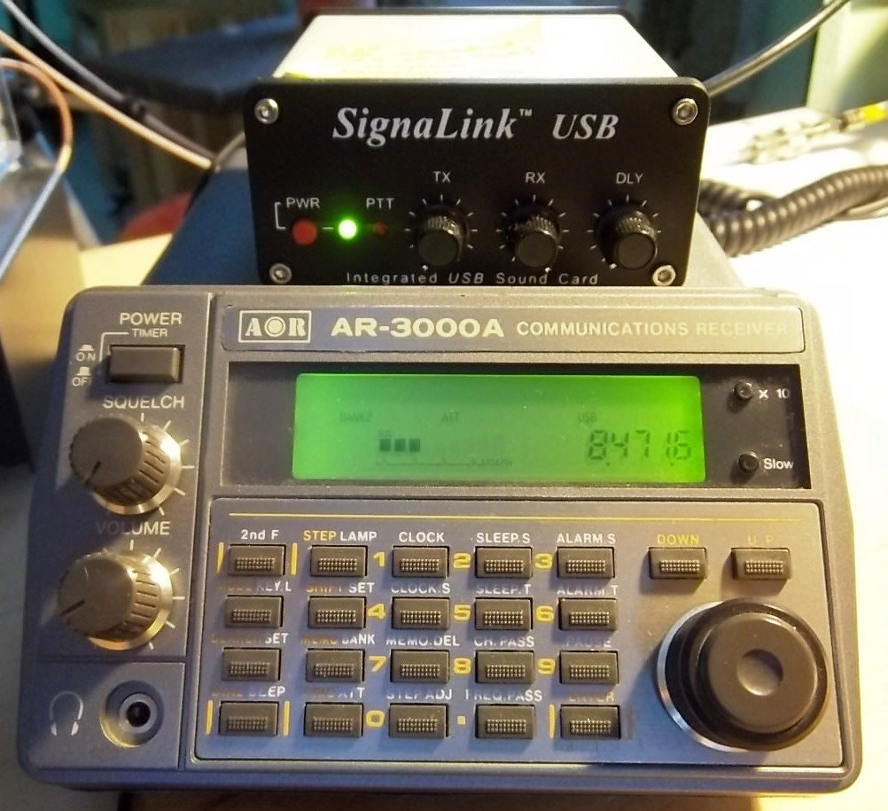 Tabletop SW radio set to WLO; SignaLink USB links radio to computer for decoding.