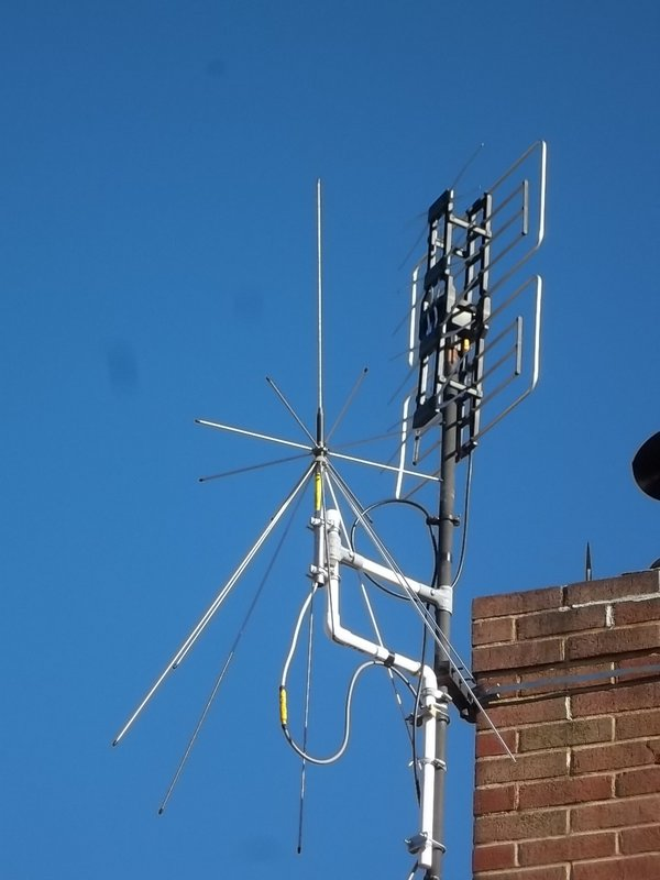 Radio Shack discone offset –mounted on TV antenna mast.