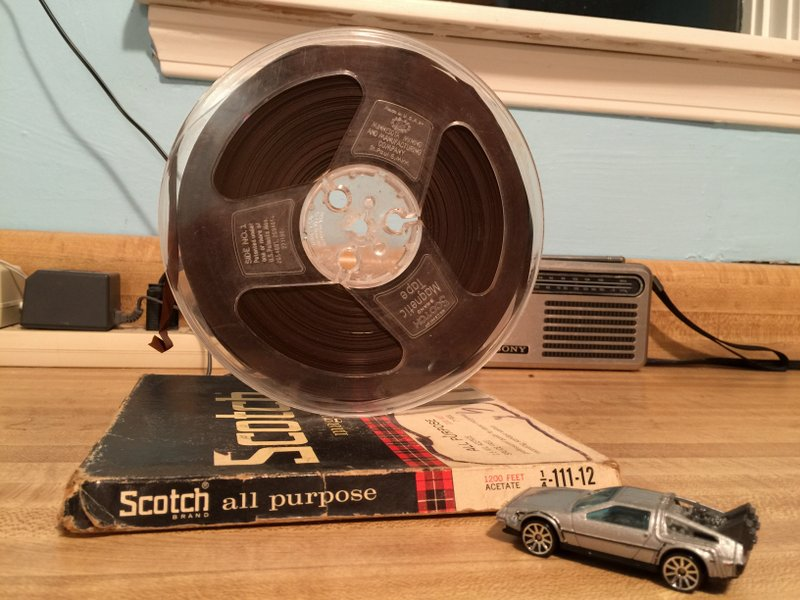 Paul's 1976 tape reel containing this Radio Netherlands recording. He felt the DeLorean added a touch of time travel.