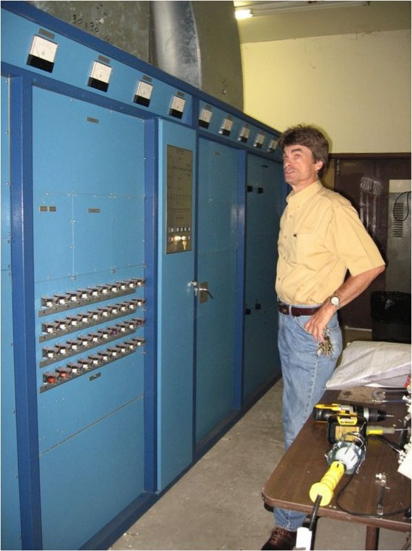 Figure 1. Larry describes the Elcor transmitter. In the foreground is the control cabinet with the control relays out front for easy access.