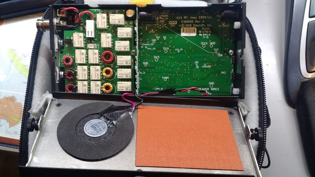 View of the Elecraft KX2 battery compartment. Note the speaker wires which attach the two halves of the chassis.